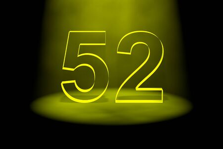 spotlit: Number 52 illuminated with yellow light on black background