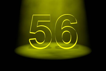 Number 56 illuminated with yellow light on black background photo