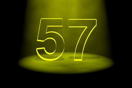 57: Number 57 illuminated with yellow light on black background Stock Photo
