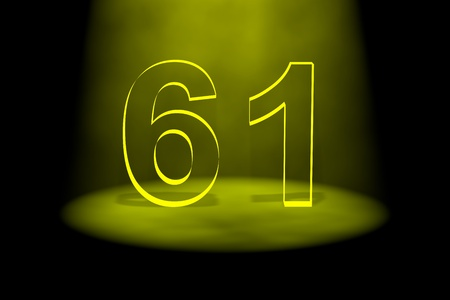 spotlit: Number 61illuminated with yellow light on black background