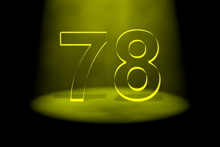 spotlit: Number 78 illuminated with yellow light on black background Stock Photo