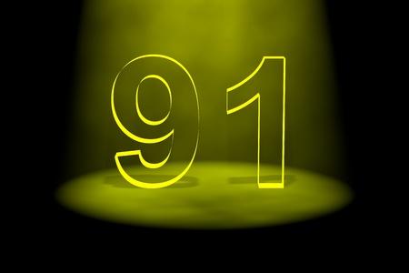 spotlit: Number 91 illuminated with yellow light on black background