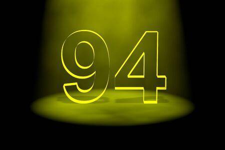Number 94 illuminated with yellow light on black background photo