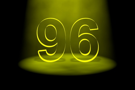 spotlit: Number 96 illuminated with yellow light on black background