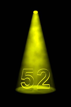 Number 52 illuminated with yellow spotlight on black background