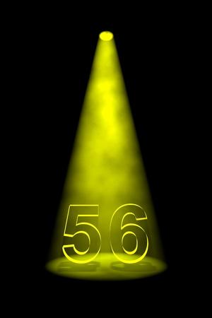 Number 56 illuminated with yellow spotlight on black background photo