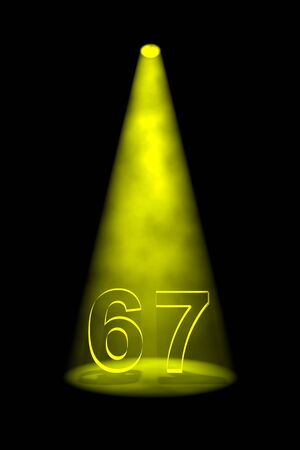 limelight: Number 67 illuminated with yellow spotlight on black background