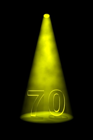 limelight: Number 70 illuminated with yellow spotlight on black background Stock Photo