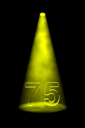 spotlit: Number 75 illuminated with yellow spotlight on black background