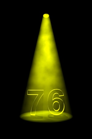 Number 76 illuminated with yellow spotlight on black background Stock Photo - 13588591