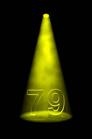 spotlit: Number 79 illuminated with yellow spotlight on black background Stock Photo