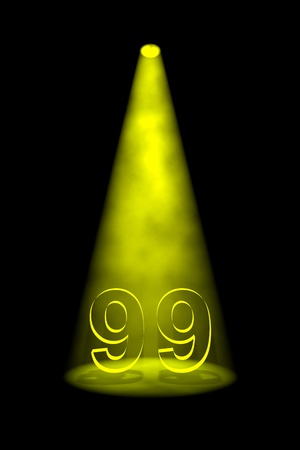 limelight: Number 99 illuminated with yellow spotlight on black background