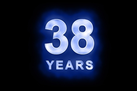 38: 38 Years in glowing white numbers and text with a mottled patterning on blue background suitable for a birthday, celebration or anniversary Stock Photo
