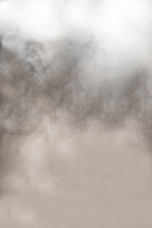 Dynamic background of thick clouds of grey and white swirling smoke from a burning fire or fog with an ethereal spiritual quality Stock Photo - 14377685