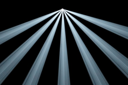 top seven: Background illustration of seven divergent symmetrical white spotlight beams from a single light source at the centre top shining in smoky darkness
