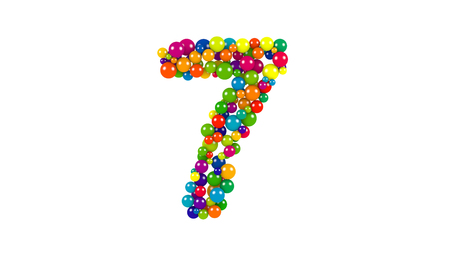 Various sized green, red, blue and yellow balls in the shape of number the seven over white background Stock Photo