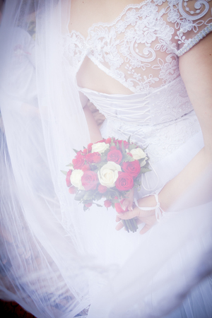 Wedding bouquet. Bride's flowers, plant, red style natural hands