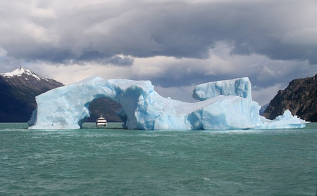 Iceberg floating in Lago Argentino broken off from the Perito Moreno Glacier photo