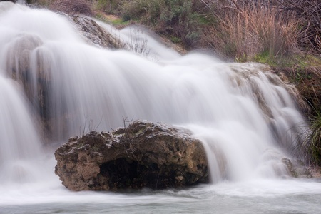 A view of a waterfall between two gaps