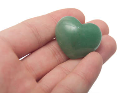 offering a chakra stone with heart shape  Stock Photo - 12743039