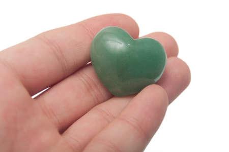 heart chakra: offering a chakra stone with heart shape  Stock Photo