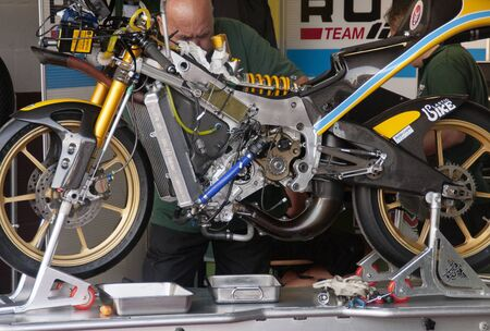 ALBACETE, SPAIN - OCT 8:  the 125 motorcycle drived by Hiroki Ono for Rumi 125GP Team is in the set up before the race at 2011 european championship of 125GPMoto3 class, on October 8, 2011, in Albacete, Spain
