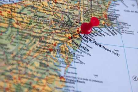 New York marked in an atlas with a pushpin