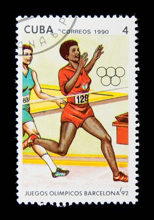 CUBA  - CIRCA 1990: A stamp printed in Cuba shows an athlete finishing the hundred-meter race, series Olympic Games in Barcelona 1992, circa 1990