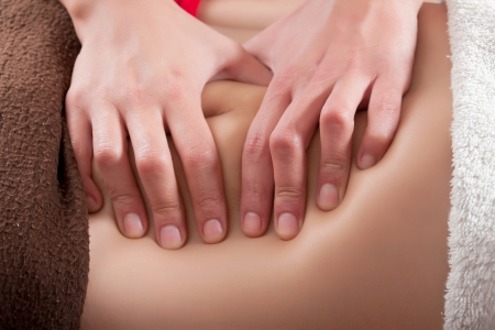 osteopathy procedure on the belly photo