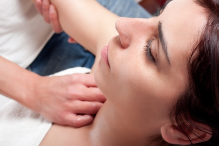 osteopathy procedure in a shoulder of a young woman