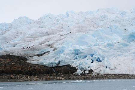 icescape: People doing trekking on perito moreno glacier