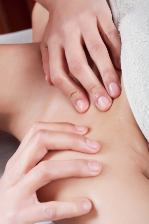 osteopathy procedure in the shoulder and the neck of a young woman