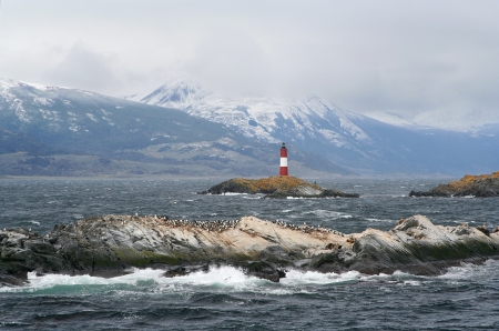 ushuaia lighthouse, called the world ends lighthouse, sorrounded by islands full of cormorant birds
