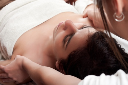 osteopathy procedure in both shoulders of a young woman photo