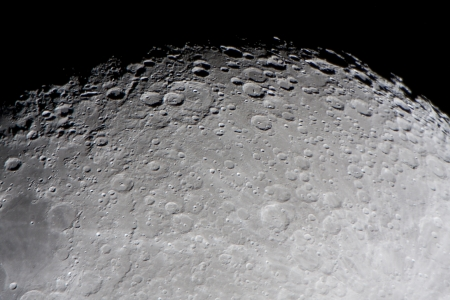 craters: picture of the moon surface by telescope  This zone is called terminator, twilight zone or grey