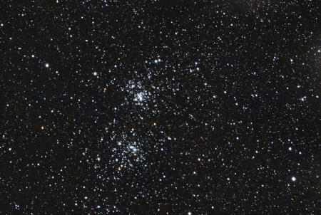 clusters: the famous stars double cluster in the constellation of perseus  The image is taken in the in prime focus of professional telescope  This is a very deep and real image, so the noise in background is no noise, these are very very dim stars again The image