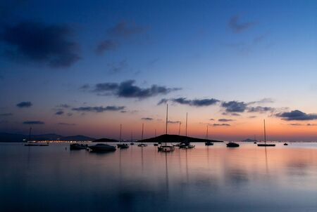 sunrise over sailboats photo