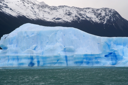 great iceberg floating in water, near of perito moreno glacier, in Argentina photo