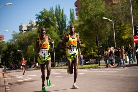 ALBACETE - MAY 8: Unidentified runners on the street during Albacete half marathon on May 8, 2011 in Albacete, Spain