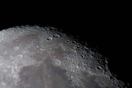 picture of the moon surface by telescope  This zone is called terminator, twilight zone or grey photo