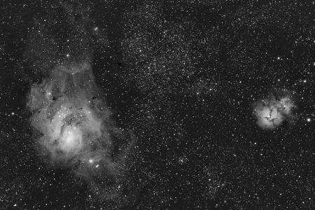 astroimage: infrared real astronomical picture taken by telescope of greats lagoon and trifid nebulas located in sagittarius constellation. They can be seen during summer