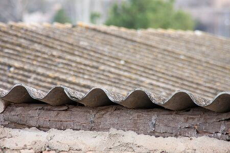 a view of a traditional fibre cement roof of a spanish town house photo