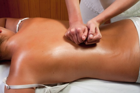 masseuse doing a therapy procedure Stock Photo