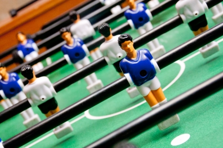 sports bar: classical table football, focused on the first figure Stock Photo