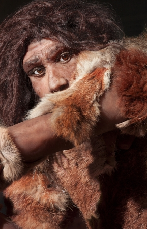 homo erectus: close view of a neanderthal man, focused in eyes expression Stock Photo