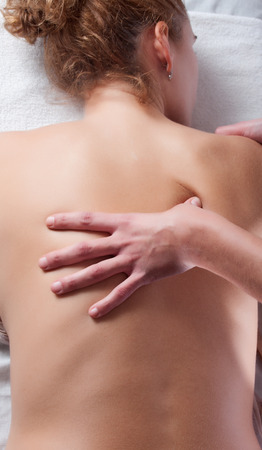 osteopathy: massaging a young womang. Picture related with taking care, wellness, relax and spa