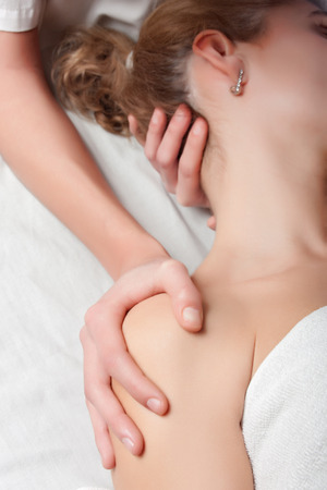 osteopathy: stretching ostheopathy procedure in the neck and the shoulder