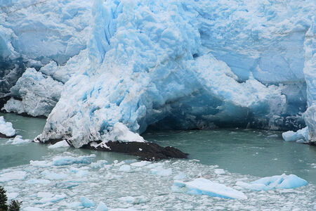 icescape: north border of perito moreno glacier is stoped when reaches first roks and land. a cavern is formed and falls every 5 years. the process is at the beginning in this picture