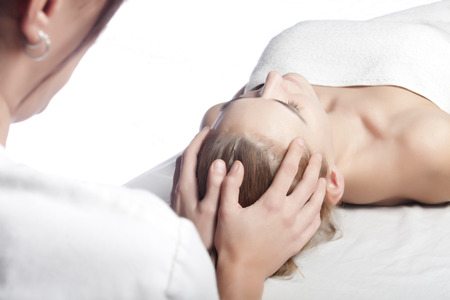 a young woman is receiving a relaxing massage Stock Photo