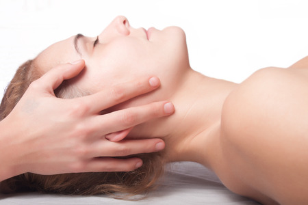 osteopathy: a young woman is being treated by a masseuse